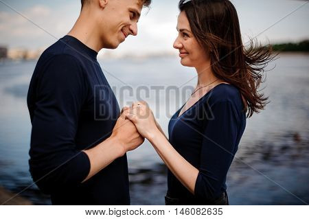 young happy lovers looking at each other