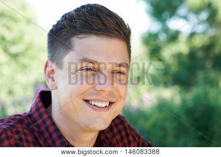 Outdoor Head And Shoulders Portrait Of Smiling Man