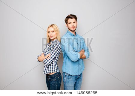 Man And Woman In Love With Crossed Hands On Gray Background