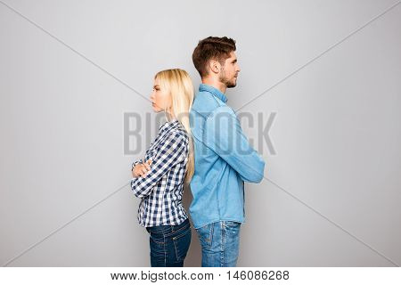Man And Woman With Crossed Hands Standing Back To Back