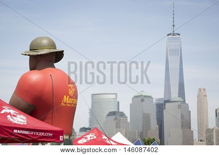 JERSEY CITY NJ MAY 29 2016: Giant inflated balloon of a US Marine Corpsman at Liberty State Park with the Freedom Tower and New York City skyline in the background seen during Fleet Week 2016.