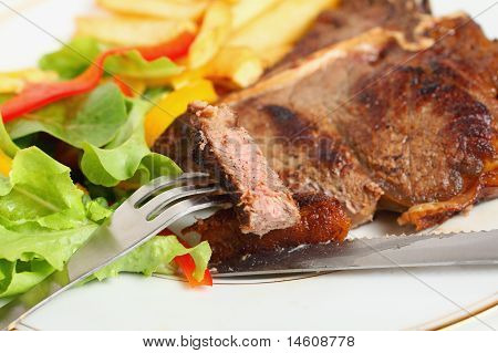 Eating T-bone Steak