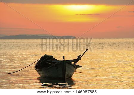 Silhouette of traditional fishing boat at sunrise Koh Rong island Cambodia Southeast Asia