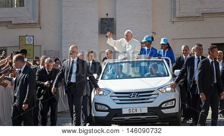 Vatican State - September 3 2016: Pope Francis on the new convertible car waving to the crowd of faithful gathered in St. Peter's Square for the sanctification of Mother Teresa of Calcutta.