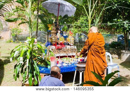 CHIANG RAI THAILAND - SEPTEMBER 1 : unidentified thai monk ritualising in front of altar tables in ancient Thai traditional style on September 1 2016 in Chiang rai Thailand.