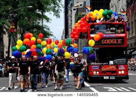 New York City - June 30 2007: Google Bus and marchers with rainbow flag colour balloons at the 2007 Gay Pride Parade on Fifth Avenue
