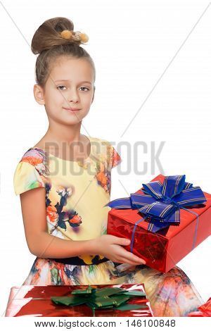 Dressy girl holds box with gift - Isolated on white background