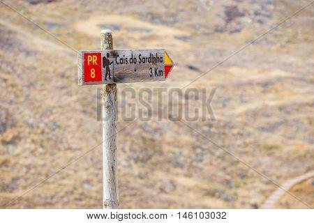 Hiking route wooden sign pointing to Ponta de Sao Lourenco. Madeira Portugal
