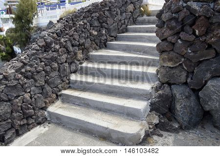 Outdoor steps with volcanic rock walls in Torviscas a coastal town in Costa Adeje Tenerife