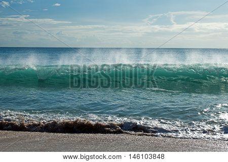 Turquoise ocean waves on the beach and dreamland beach