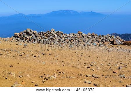 Pile of rocks taken at the summit of Mt Baldy, CA which is 10,000 feet above sea level overlooking the Southern California landscape