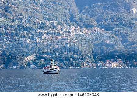 Ferry leaving Varenna town in the direction of Cadenabbia and Menaggio at Lake Como, Italy