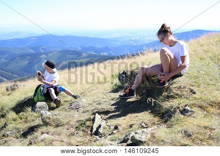 Vacation in the mountains.Resting on the trail of a mountain expedition.