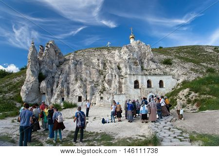 DIVNOGORIE VORONEZH REGION RUSSIA - JUNE 12 2016: People near the Orthodox cathedral carved out of natural rock Russia Voronezh region museum Divnogorie June 12 2016