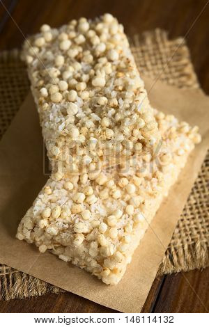 Baked marshmallow popped quinoa and coconut bars photographed with natural light (Selective Focus Focus on the front edge of the upper bar)