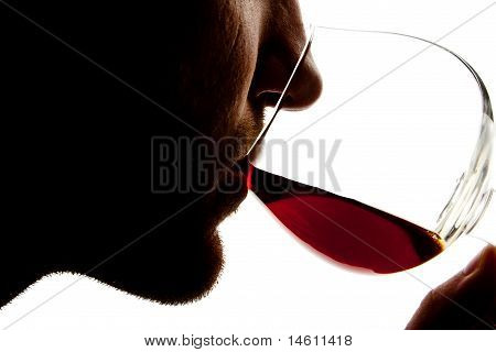 Silhouette Of Man Tasting Alcohol