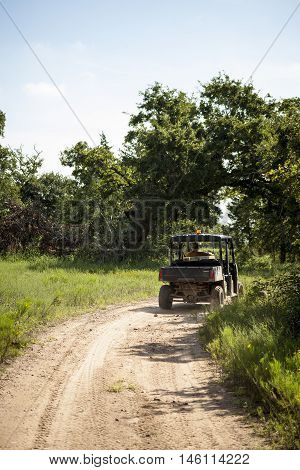 An off road ATV travels down a winding hiking trail.