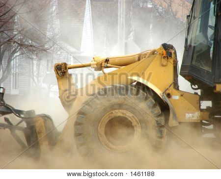Excavator in Construction Dust