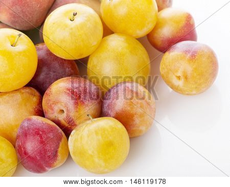 Pile of colorful summer fruits - plums and peaches