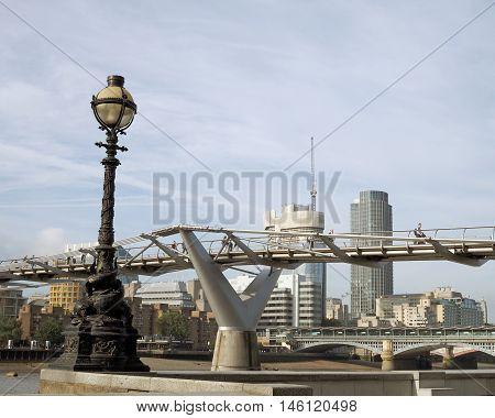 Millennium bridge over the Thames river in London