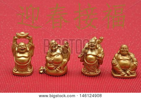Chinese New Year design. Laughing cheerful Buddha isolated against a red background. Translation : Greet the new year and encounter happiness