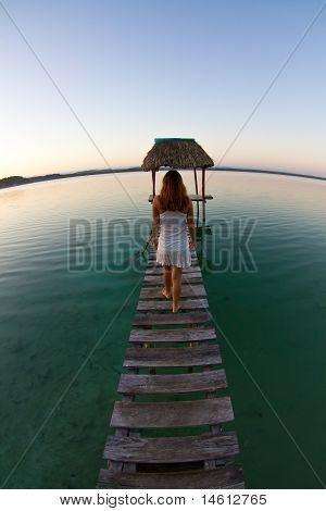 A Girl Refelecting On A Tranquil Lake