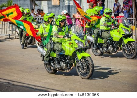 BARRANQUILLA, COLOMBIA - FEBRUARY 15, 2015: Police in motorcycles participate in Colombia's most important folklore celebration, the Carnival of Barranquilla, Colombia