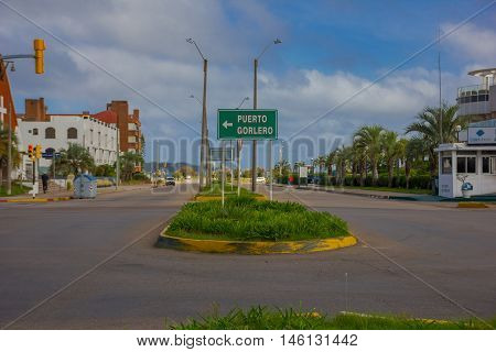 PUNTA DEL ESTE, URUGUAY - MAY 06, 2016: small sign indicating the direction to puerto gorlero.