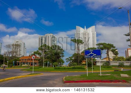 PUNTA DEL ESTE, URUGUAY - MAY 06, 2016: nice street close to some modern buildings with some trees on the sidewalks