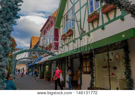 BLUMENAU, BRAZIL - MAY 10, 2016: unidentified people visiting some local stores at the city center.