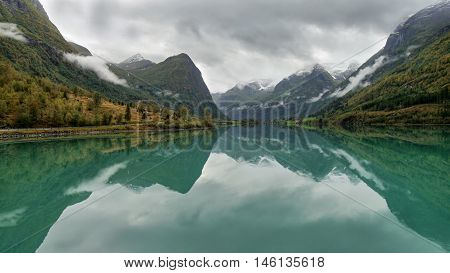 Green glacial lake in the Norwegian mountains