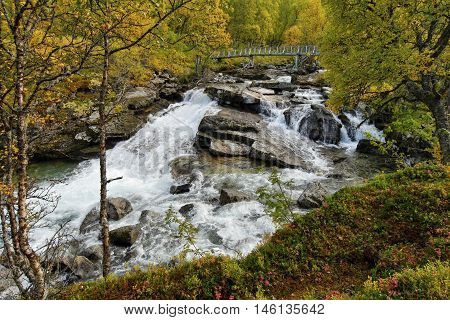 Waterfall on the river in the Norwegian mountains