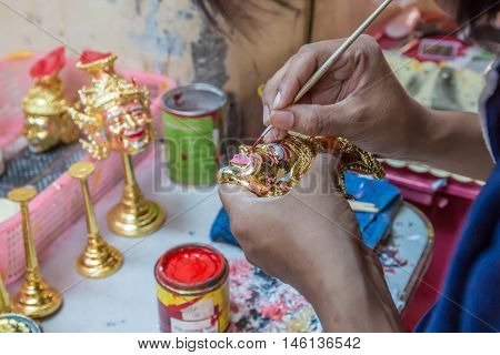 Men's Hands paint on Hua Khon (Thai Traditional Mask) Used in Khon.