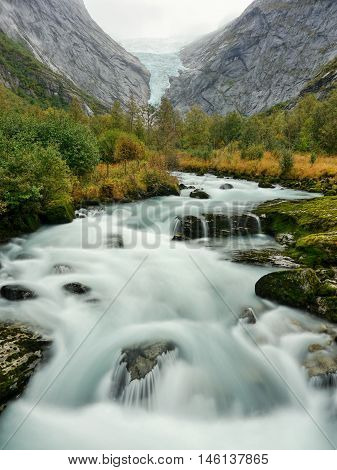 Glacial river in autumn mountains, Southern Norway
