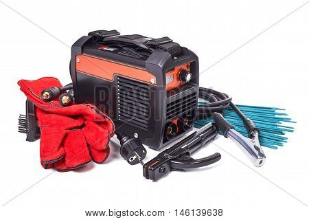 Inverter welding machine, welding equipment, isolated on a white background, leather gloves, welding electrodes, high-voltage wires with clips, set of accessories for arc welding