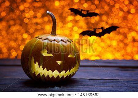Pumpkin for Halloween, lamp pumpkin, bat silhouette, antique wood, celebrate Halloween, pumpkin smiley on a bright background