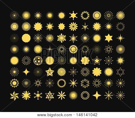 Complete set of 80 golden stars, flowers, sunbeams, snow flakes, signs and symbols icons on black background