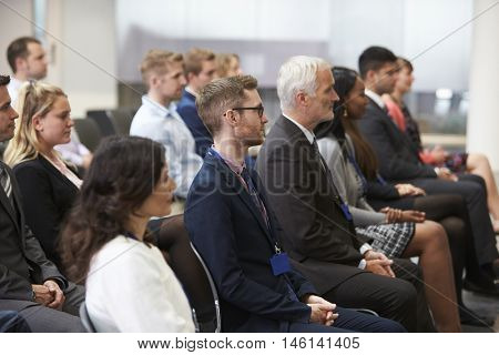 Audience Listening To  Speaker At Conference Presentation