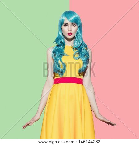 Pop art woman portrait wearing blue curly wig and bright yellow dress.  Green-rose background. Space for text.