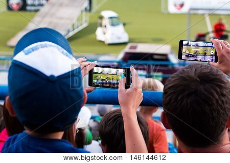 Russia Kirov - August 09 2016: Spectators are taking pictures of extreme auto show in Kirov city in 2016