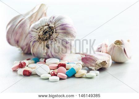 Pills and garlic. Natural antibiotics.