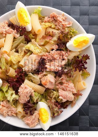 African tuna salad with eggs and pasta. Shot from above vertical shot