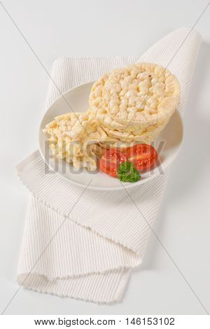slices of puffed rice bread on white plate
