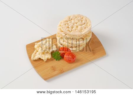 slices of puffed rice bread on wooden cutting board