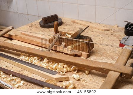 carpenter workinghammermeter and screw-driver on construction background.