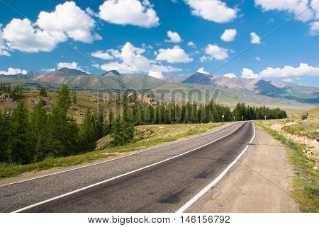 Countryside road in the valley. Altay mountains.