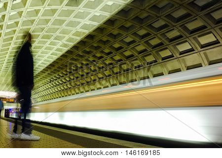 Washington D.C. - Subway station with passengers and train in motion blur