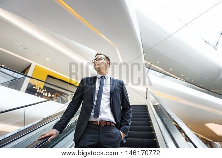 Business Man Looking Escalator Thinking Concept