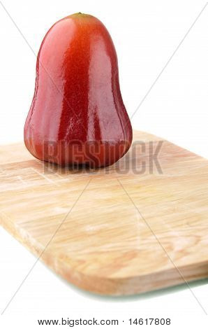 One Red Rose Apple On Chopping Board