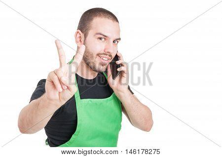 Handsome Supermarket Employee Showing Peace Gesture
